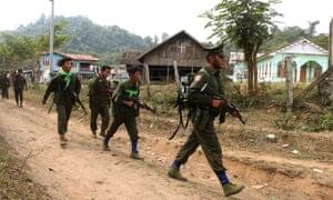 Kachin Independence Army (KIA) soldiers walk through Ka Htang Yang village in Kachin State.