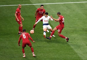 Spurs try and find a way back into the game but on this occasion Son Heung-Min finds himself crowded out by Liverpool's defence