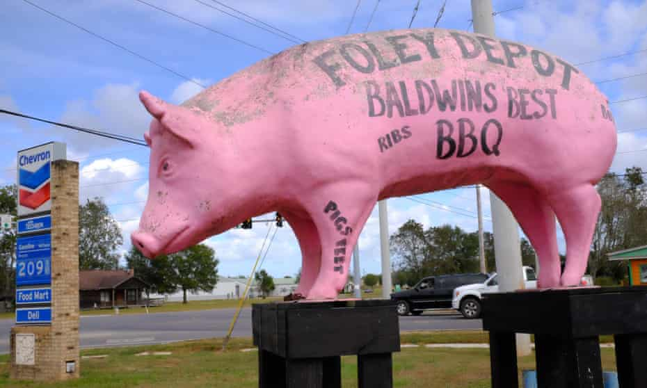 Huge Pink plastic pig in front of the Depot Chevron barbecue gas station in Foley, Alabama
