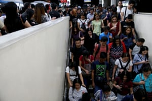 Janice Sarad, 22, who works for a bank, exits the Cubao MRT station in Quezon City