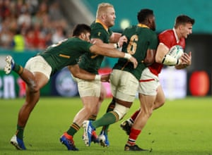 Andrew Coe of Canada attempts to evade Siya Kolisi, Vincent Koch and Damian De Allende (left) of South Africa.