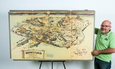 Art dealer Mike Van Eaton stands next to a hand-drawn map from 1953 that shows Walt Disney's original ideas for Disneyland