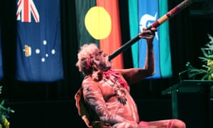 The didgeridoo is played at a memorial service at the Melbourne Exhibition building on Monday night to mark 10 years since the Black Saturday bushfires in Victoria.