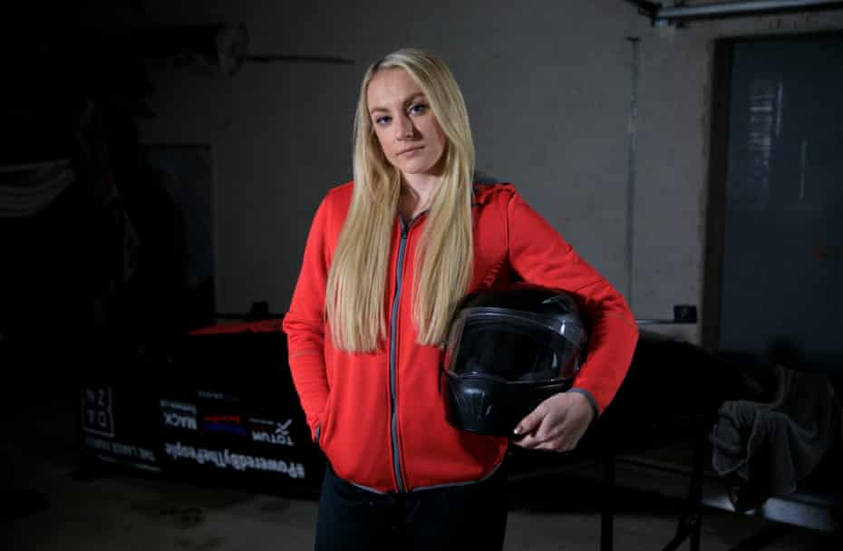 Mica McNeill, the pilot of the GB women's bobsleigh team, stands by 'Sid' in the garage in Berchtesgaden.
