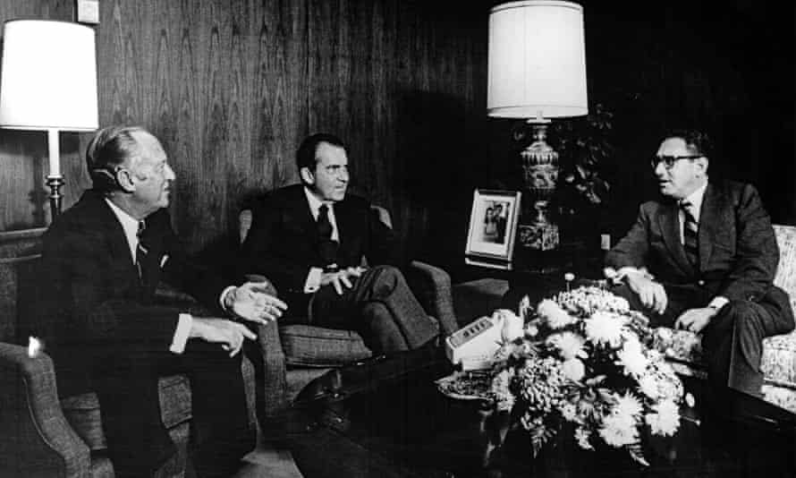 Richard Nixon, centre, meets Henry Kissinger, right, and US Secretary of State William P Rogers, left. Kissinger was reporting to Nixon and Rogers about his secret trip to Beijing, China to meet with Zhou Enlai.