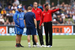 Cricketers talking to umpires