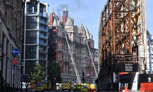 Firefighters tackle a blaze at the Mandarin Oriental hotel in central London.