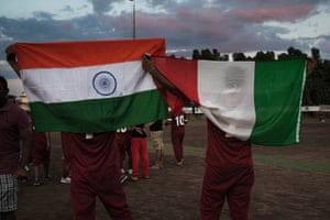Gurpreet and his friend show both the Italian and Indian flags after winning the first official cricket tournament set up in Pontina by local NGOs
