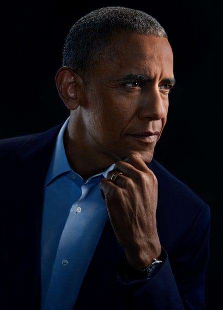 Head shot of Barack Obama against black background