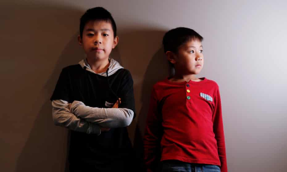 The tournament's youngest competitor, Jeffery Lam (right), with brother and fellow Scrabbler Alex.