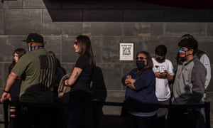 People wearing face masks and not stand in line in front of Hodads Restaurant in Ocean Beach in San Diego, California on February 13, 2021.