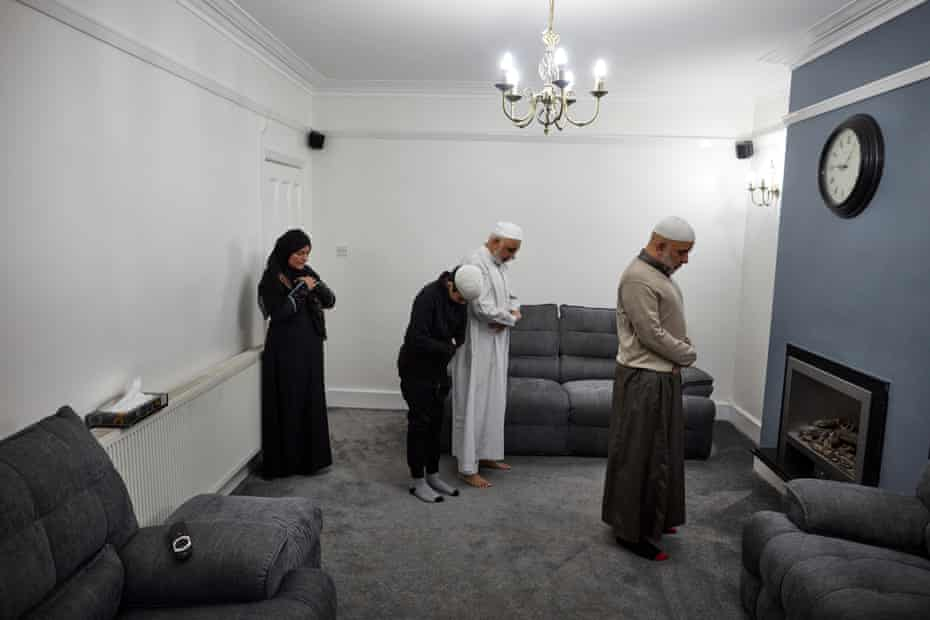 15 May: Irhfan Mururajani leads his family in prayer at their home in Leicester during Ramadan.