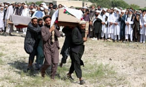 People attend the funeral of victims of a US drone strike in Khogyani district of Nangarhar province, Afghanistan, on 19 September.