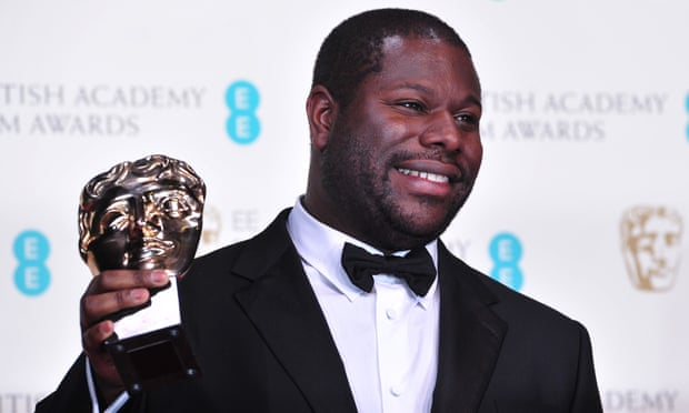 Steve McQueen with his Oscar for best film for 12 Years a Slave. He wants fast-track training and access for talented BAME youngsters to the British TV and film industry. Photograph: Carl Court/AFP via Getty Images