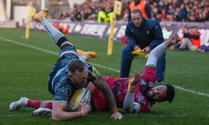 Byron McGuigan dives over to score during a rampant start from Sale, who eventually needed Faf de Klerk's late penalty to win a thrilling game against Harlequins.
