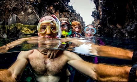 The Halls family snorkelling in Las Grietas. in My Family and The Galapagos.