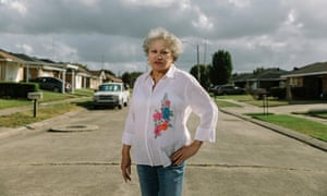Marilyn Amar stands in front of her home in the Gordon Plaza neighborhood, where she's lived since 1990. Gordon Plaza is a subdivision developed by the city of New Orleans in 1981 atop the Agriculture Street landfill, which was closed in 1965. New homeowners were not told that their homes were built on top of the dump at time of purchase. Two other city-owned properties built on the landfill - Morton Elementary School and Press Park housing project - have since been abandoned after the EPA declared the area a Superfund cleanup site in 1994. Gordon Park residents have been trapped in their homes, fighting for a buyout to facilitate a relocation. Without government assistance, relocating is impossible for most residents since their homes have little resale value.
