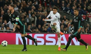 Dele Alli of Tottenham Hotspur scores his side's second goal via a big deflection off Sergio Ramos, left.