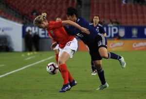 Ellen White of England holds off Arisa Matsubara of Japan.