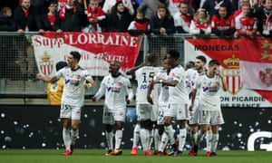 Amiens players celebrate after taking the lead against Monaco.