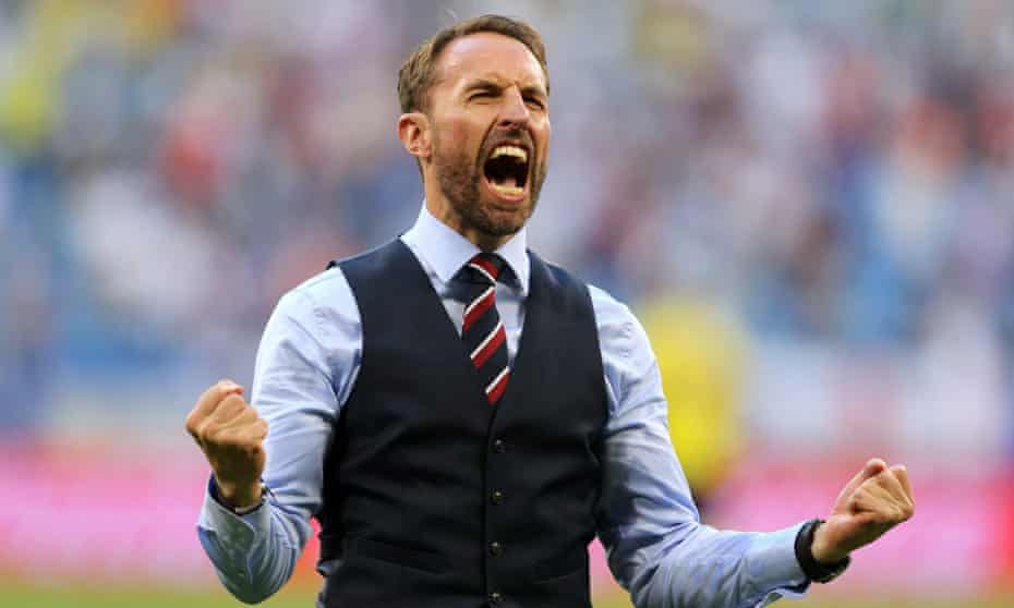 Gareth Southgate celebrating an England goal during the team's World Cup quarter-final match with Sweden.