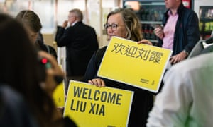 People wait at Berlin airport to welcome Liu Xia