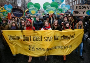 Participants carry a banner reading 'Ukraine! Don't cheat – save the climate' as they march in Kiev, Ukraine