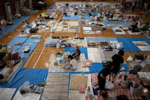 Evacuees rest at a makeshift shelter in Mabi