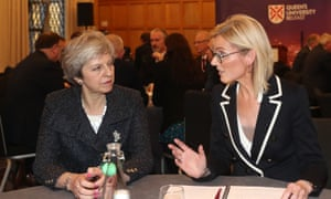 Theresa May meets with Nora Smith, chief executive of CO3, at Queen's University in Belfast.