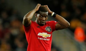 Pogba reacts after his penalty is saved.