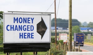A large road sign tells drivers where to change money on the border south of Newry