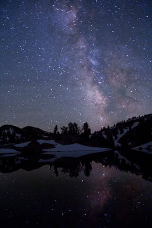 The Milky Way reflected in Sky lake, near 8,000ft elevation in the Eagle Cap wilderness area of Oregon