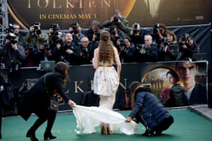 London, UK Lily Collins poses for photographer at the 'Tolkien' film premiere