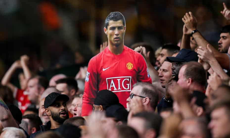 A cardboard cutout of Cristiano Ronaldo is passed around the Manchester United fans at Wolves. He is poised to make his second United debut against Newcastle.