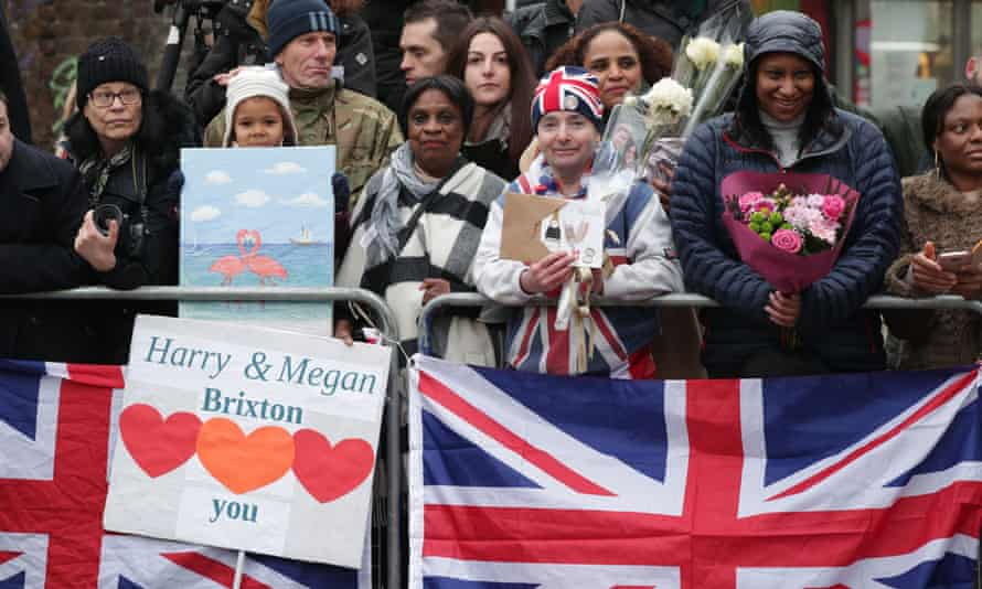 Members of the public wait before the royal couple's visit to Brixton in January this year.