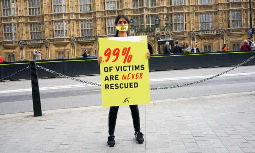 A protester against human trafficking outside parliament in London.