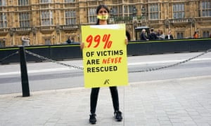 A woman campaigns against modern-day slavery outside London's Houses of Parliament