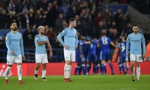 Manchester City's players look dejected after Ricardo Pereira's late winner for Leicester