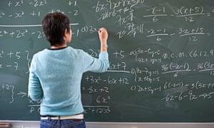Teaching writing maths problem on blackboard