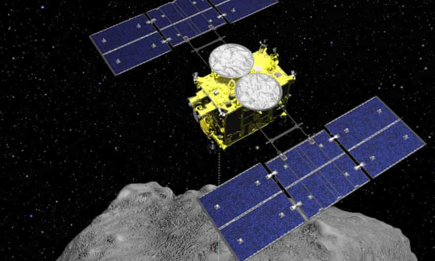 A computer graphic image of the Hayabusa2 spacecraft on the asteroid Ryugu