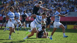 Argentina's scrum-half Gonzalo Bertranou (centre) runs through to score a try.