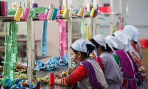 Bangladeshi workers at a garment factory on the outskirts of Dhaka