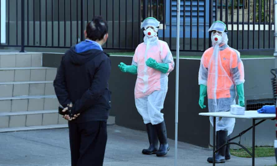 Cleaners in Hazmat suits arrive a locked down tower block in Blacktown in Sydney's west after a Covid-19 outbreak.