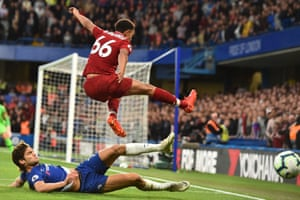 Chelsea's Marcos Alonso thwarts Liverpool's Trent Alexander-Arnold.