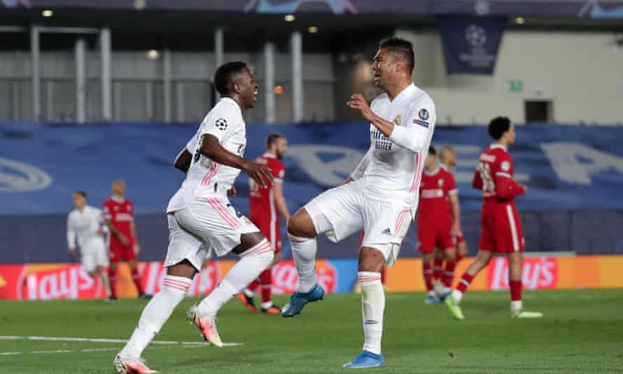 Vinícius Júnior celebrates with Casemiro after scoring his second goal of the game.