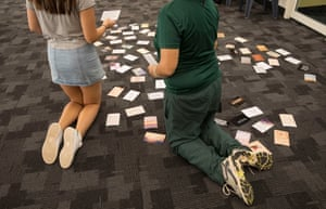 Cards with positive messages have been placed on the floor in a heart shape by Shine For Kids staff.
