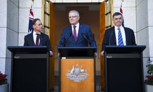 Health minister Greg Hunt, prime minister Scott Morrison and chief medical officer Prof Brendan Murphy hold a press conference at Parliament House.