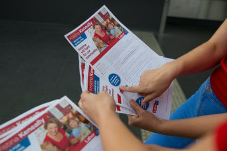 Labor supporters handing out flyers.