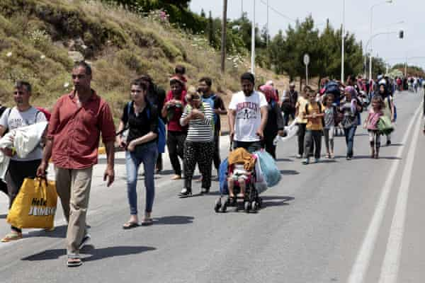 Refugees and migrants from Moria march towards Mytilene during a protest over the camp's conditions
