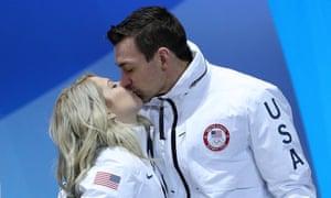 Chris and Alexa Scimeca Knierim celebrate their Olympic bronze medal with a kiss.